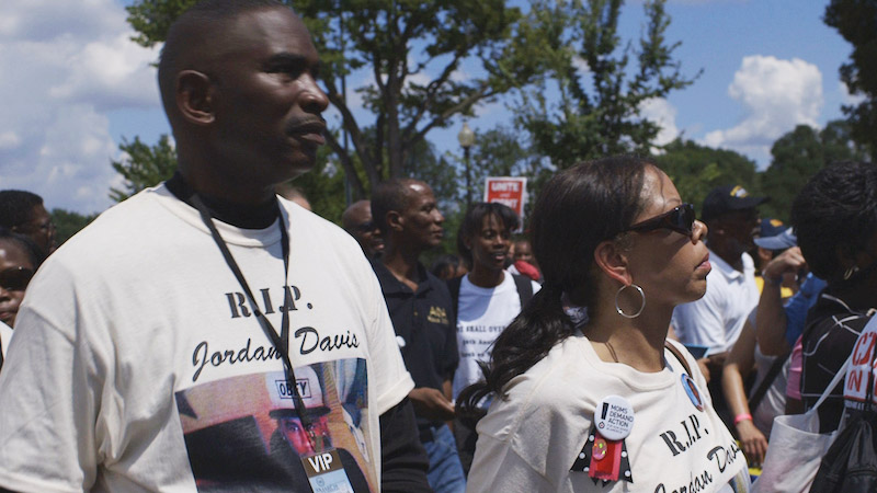 3 ½ MINUTES TEN BULLETS IMAGE 6 - Ron Davis and Lucia McBath at Rally
